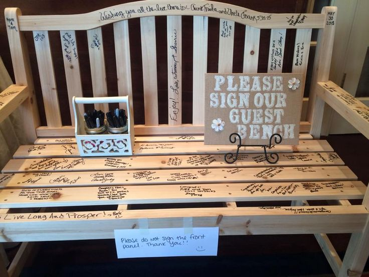 Check out this idea from a wedding we did this weekend. Having the guests all sign their bench - that is one cool guest book to remember your wedding day by!
