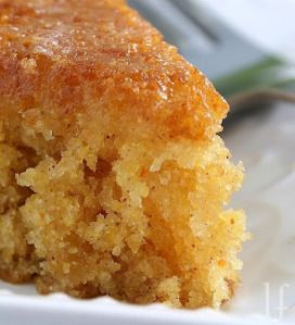 CORNBREAD CAKE 2 cups flour 1 1/2 cups yellow cornmeal  4 eggs 1 1/2 cups sugar 1/2 cup brown sugar, packed 1 cup oil 1 teaspoon vanilla One 15-ounce can whole kernel corn, undrained 1 1/2 teaspoons baking soda 1 1/2 teaspoons salt 1 teaspoon cinnamon 3/4 teaspoon baking powder  Preheat oven to 350 degrees. Coat a 9×13 oblong pan or two 9 inch cakes pans with vegetable cooking spray.