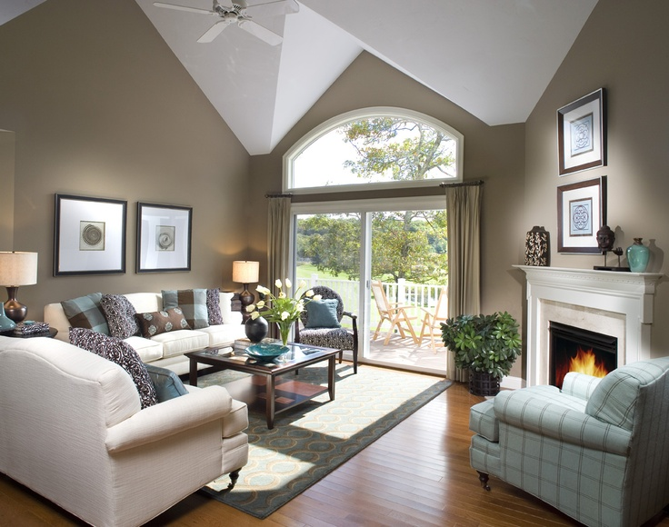 Dramatic ceilings and angled fireplace highlight this