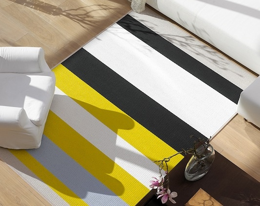 Woodnotes Avenue striped rug by Ritva Puotila. Available at SUITE New York.
