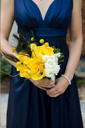 blue yellow colors.  Love everything about this especially the bridesmaid dress and peacock feather in the boquet.