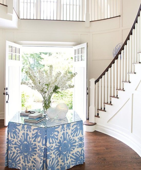Love this entryway and the tablecloth and flowers