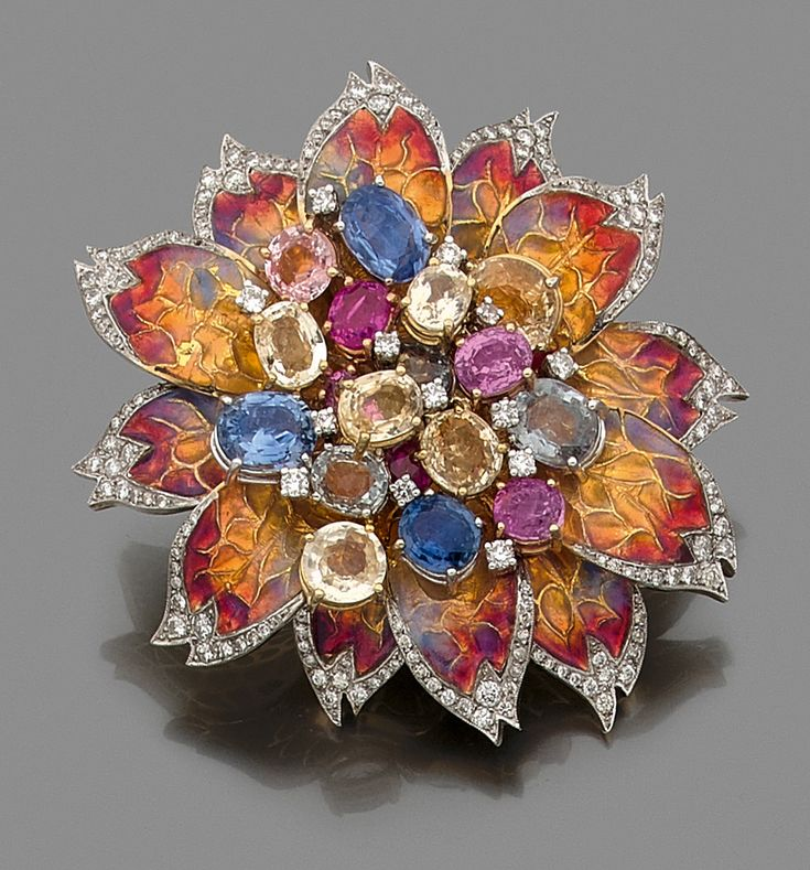 IMPORTANT FLOWER PIN It is richly adorned with pink sapphires, green, blue and yellow. The 18K yellow gold petals polychrome enamel lined with small brilliant cut diamonds