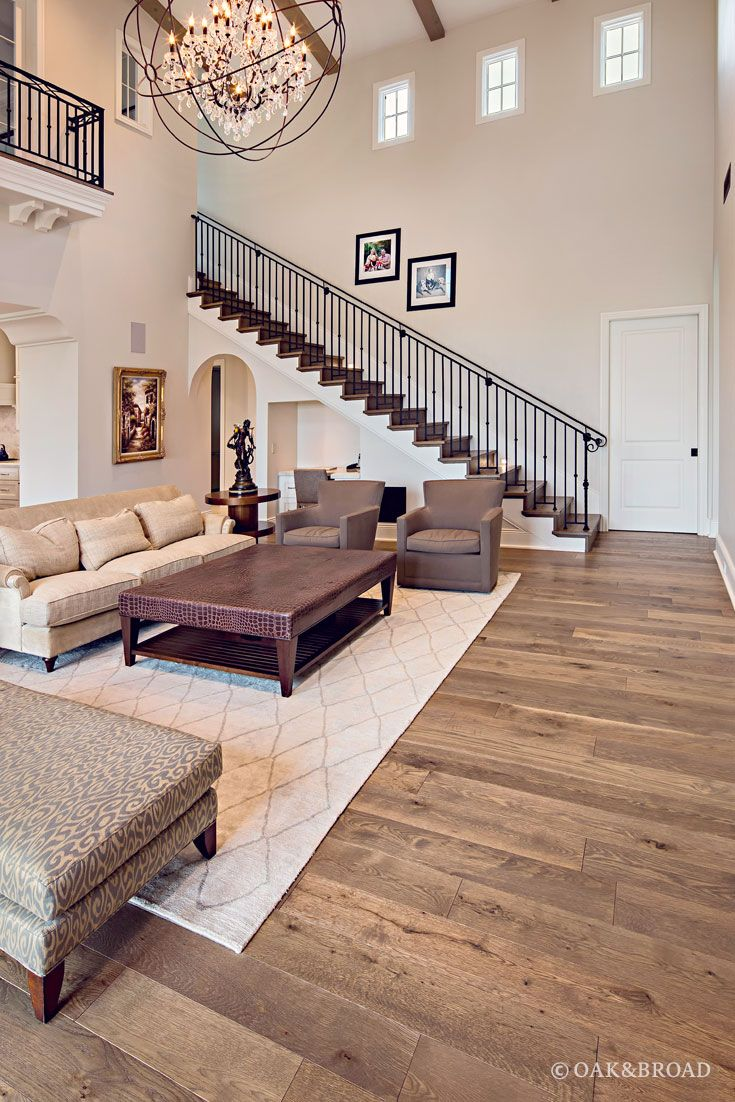 Custom Wide Plank Hardwood Floor By Oak & Broad In Living Room Of Arizona Home