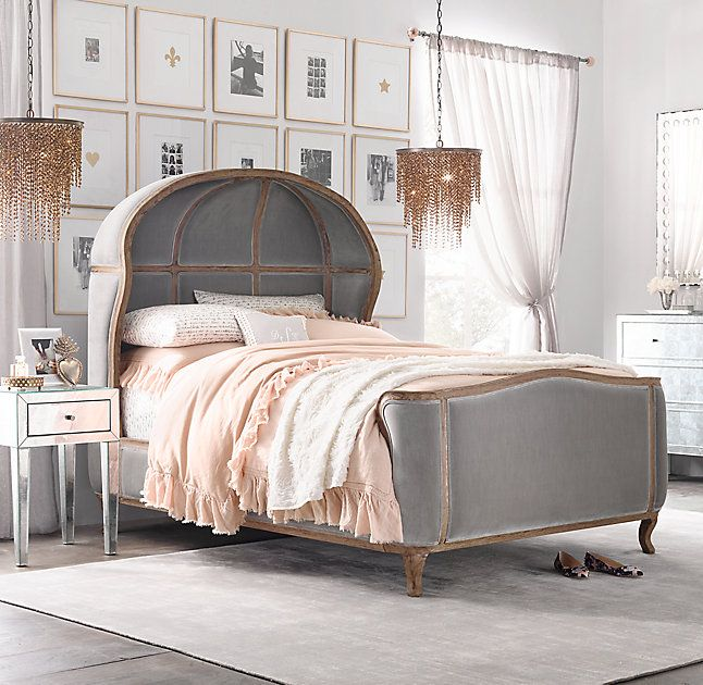 A dramatic bed and fringed chandeliers add french flair to for Dramatic beds