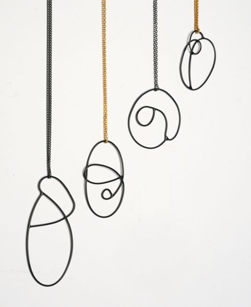 Amy Logan - 'Swirl Drop' pendants in oxidised silver and gold plated silver