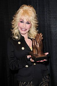 Dolly Rebecca Parton (born January 19, 1946[3]) is an American singer-songwriter, instrumentalist, actress, author, and philanthropist, known for her work in country music. Her career began as a child performer on the radio, then recording a few singles from the age of 13. She rose to prominence in 1967 as a featured performer on singer Porter Wagoner's weekly syndicated TV program.