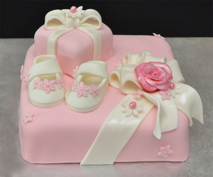 Pink and white baby shower box cake with shoes and other accessories. The Momma-to-be LOVED this cake as did all of her friends!