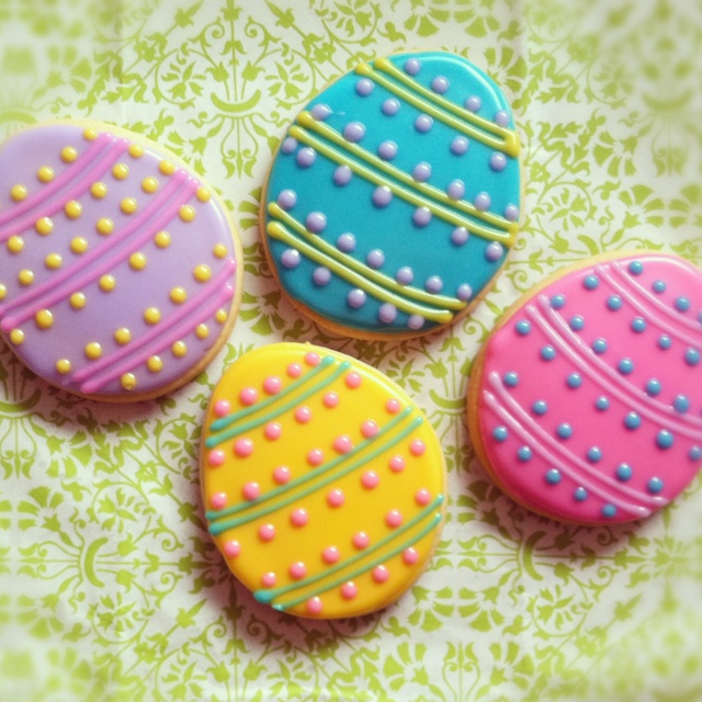 Easter egg sugar cookies decorated with glaze icing. By ...