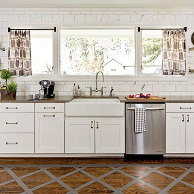 Classic #Kitchen Palette | White cabinets, white marble backsplash tiles, Lagos blue limestone countertops, and stainless steel appliances create a backdrop that's simple and fresh.