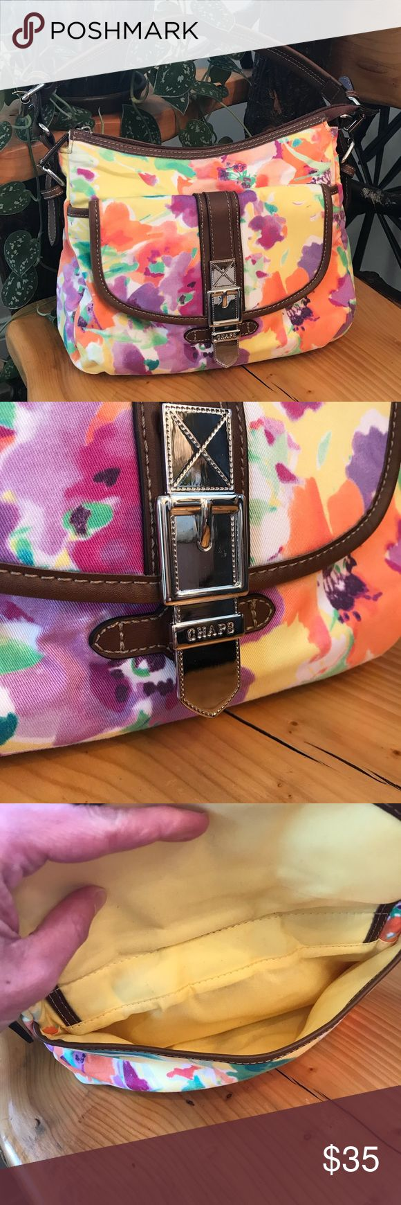 """Chaps Ralph Lauren Watercolor Flowers Bag EUC. Perfect for Spring! Bright and sunny watercolor flowers print with leather and metal accents. Front pocket has magnetic closure, main opening is zipper closure. Interior is yellow with one zippered pocket and 2 open pockets. There is also a zippered pocket in the back. Leather base. No flaws except one tiny pen mark on the inside (last pic). Approximate measurements are 11"""" width, 9"""" height, 3 1/2"""" depth and strap drop is 10"""". Strap length is…"""