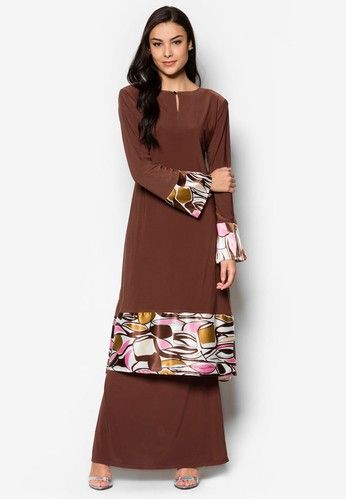 Raisya Mini Kurung from Zuco Fashion in Brown Zuco Fashion masters the art of creating beautiful pieces for the modern muslimah with this stunning baju kurung. It features soft, comfortable fabric and beautiful abstract prints on the flared hems.  Kurung Top  - Stretchable polyblend - Round ... #bajukurung #bajukurungmoden
