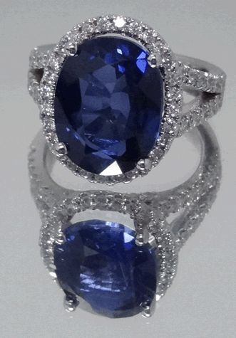 Blue sapphire engagement ring with split shank diamond band.