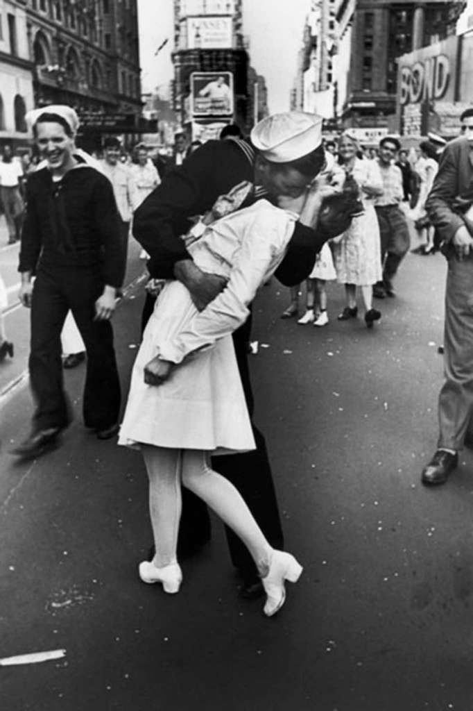 A jubilant American sailor clutching a white-uniformed nurse in a back-bending, passionate kiss as he vents his joy while thousands jam Times Square to celebrate the long awaited-victory over Japan. Photo: Alfred Eisenstaedt, Time & Life Pictures/Getty Image / Time & Life Pictures