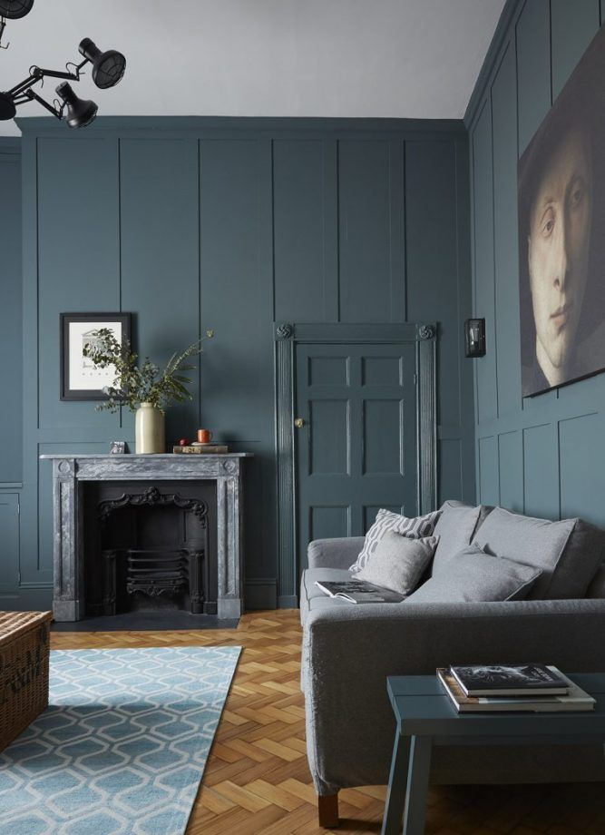 The wall is painted in Farrow & Ball's Inchyra Blue estate emulsion. The sofa is from the short-lived M&S concept shop Lifestore, re-covered in a John Lewis fabric. The 1820s fireplace was salvaged. The rug is from the Plantation Rug Company at Heal's.