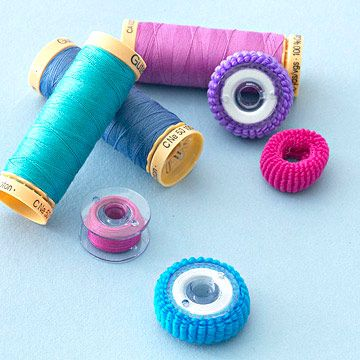 GOOD IDEA - use those funny ponytail holders to keep bobbins threads from unwinding and making a mess! probably even at the dollar store...