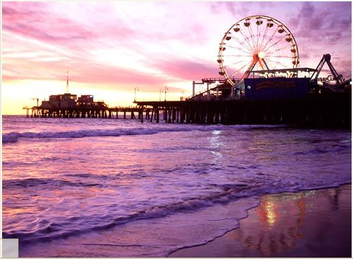 The Santa Monica Pier in Los Angeles is such a fun place. There is a nice beach, a pier with an amusement park, an antique carousel, small aquarium, street entertainers, and at the end of the pier a good Mexican restaurant.
