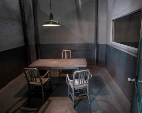 A basic stripped down interrogation room that would serve as a perfect look for a stage set up from a different angle.