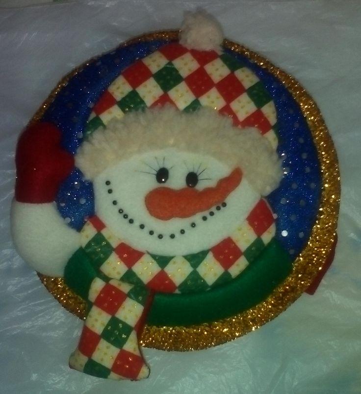 Mogolla navideña nieve saludando