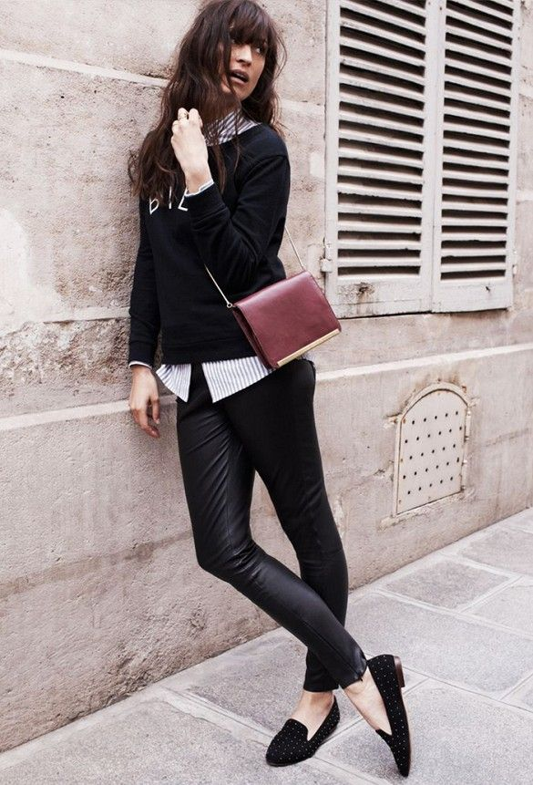 Caroline de Maigret wears a graphic sweater with black skinny pants and a maroon cross-body bag for Madewell