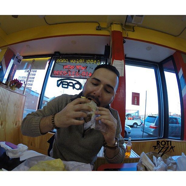 Andy was very blunt with his opinion of roti, he said it's really good and joked about how it was like a leaky diaper since the curry was falling out [He had a shrimp roti]  #Scottish #scotland #roti #dhalpourie #doubles #aloopie #trini #Baltimore #MD #gopro #USA #trinidad #cloud9 #dreamstate #westindiancuisine #westindian #CaribbeanFood #caribbean #vibes #rotipizza
