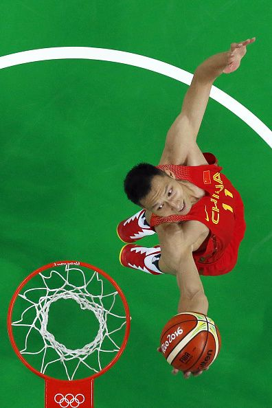 #RIO2016 #TOPSHOT An overview shows China's forward Yi Jianlian go to the basket during a Men's round Group A basketball match between Venezuela and China at...