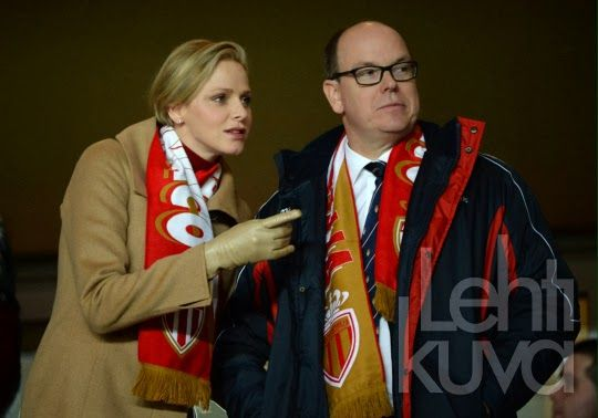 MYROYALS & HOLLYWOOD FASHION:  Princess Charlene and Prince Albert attended a soccer match between Monaco and France, February 9, 2014