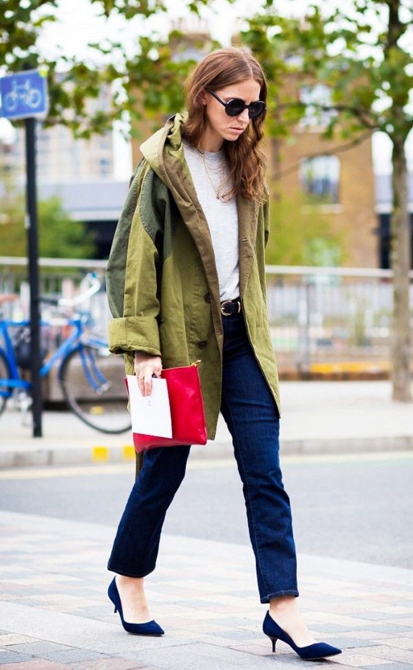 A white t-shirt is paired with an olive green anorak with dark blue jeans and kitten heels
