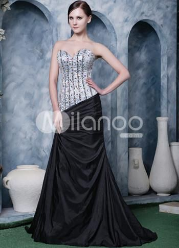 Gorgeous Silver Black Satin Beading Sweet Heart Prom Dress. Two-tone dresses can create a very dramatic effect �especially when they are embellished with design accents. This one features a strapless bodice with a sweetheart neckline and is embellished with intricately sewn rhineston.. . See More SweetHeart at http://www.ourgreatshop.com/SweetHeart-C940.aspx