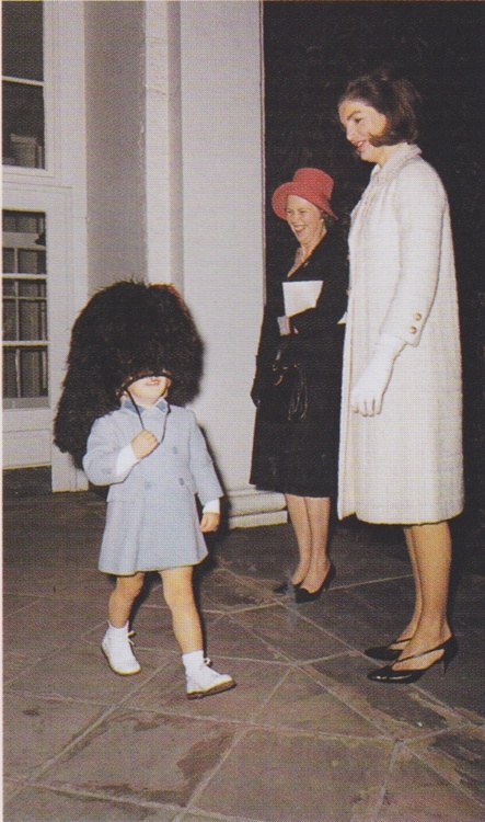 First Lady Jacqueline Kennedy with son John at the White House.