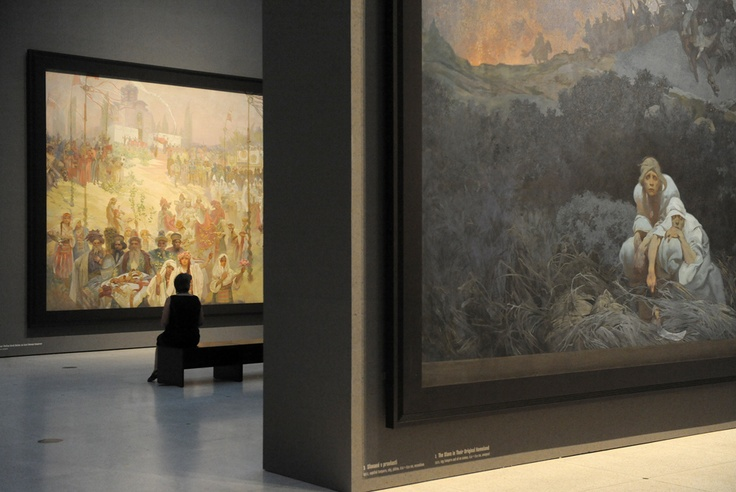"A visitor looks at the ""Slav Epic"", a cycle of 20 allegories tracing the history of the Slavic people and inspired in part by mythology, by Art Nouveau Czech artist Alfons Mucha, at the National Gallery in Prague.""The Slav Epic"" by Alfons Mucha, a Czech Art Nouveau gem, went on display in Prague, fulfilling the wish of the artist who spent 18 years on the series of paintings from 1910 to 1928. AFP PHOTO / MICHAL CIZEK.: Alfons Mucha, Art Nouveau, Czech People, Artist Alfons, Mucha Art"