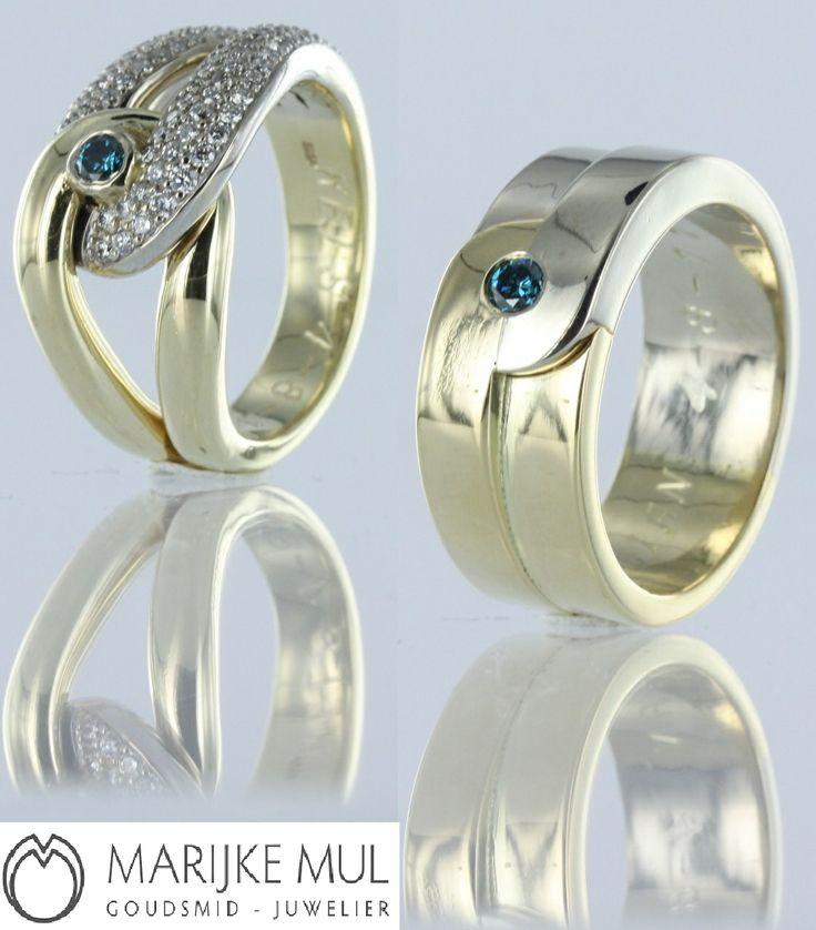 Bi-color gouden trouwring of relatie ringen. Geel en witgoud met blauw diamant. #huwelijk