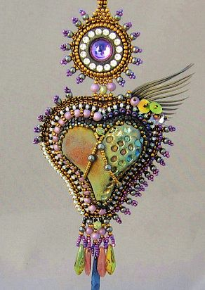 Caged Heart by Sherry Serafini!  Stunning!  She taught this class at the Bead & Button Show in 2011 and use my raku hearts in her kits.  Thank you Sherry!