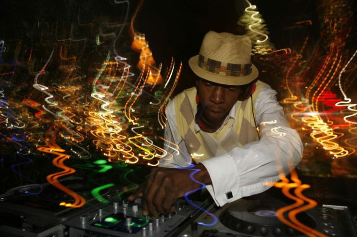 Lighting up the night. DJ Tabone in modus operandi at The Glenn Hotel, Atlanta.