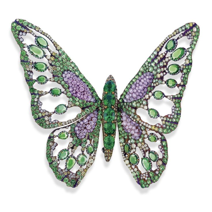 A MULTI-GEM 'PRIDE' BROOCH, BY WALLACE CHAN. Designed as a butterfly, the body set with oval and pear-shaped garnets, circular-cut yellow and brown diamonds, to the openwork vari-cut garnet and circular-cut multi-coloured diamond wings with overlapping amethyst detail, mounted in titanium and gold, 9.9 cm. Signed Wallace Chan. #WallaceChan #HauteJoaillerie #FineJewelry