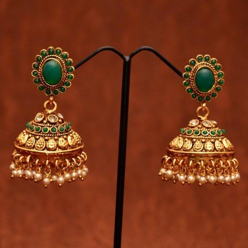 Anvi's emerald jhumkas studded with white stones and pearls