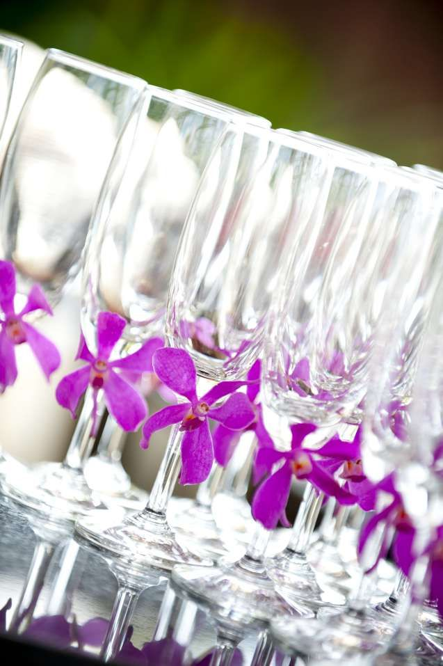 Champagne glasses dressed with purple orchids. Beach weddings, Koh Samui, Thailand