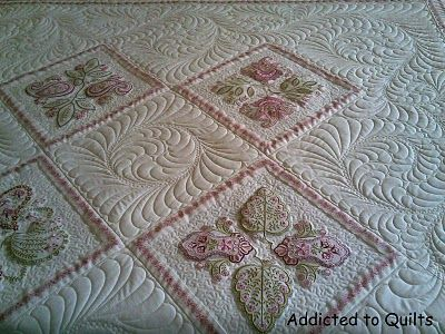 This is one of Janet Sansom's quilts that was quilted for her in 2009.       Janet designs the most exquisite embroideries.