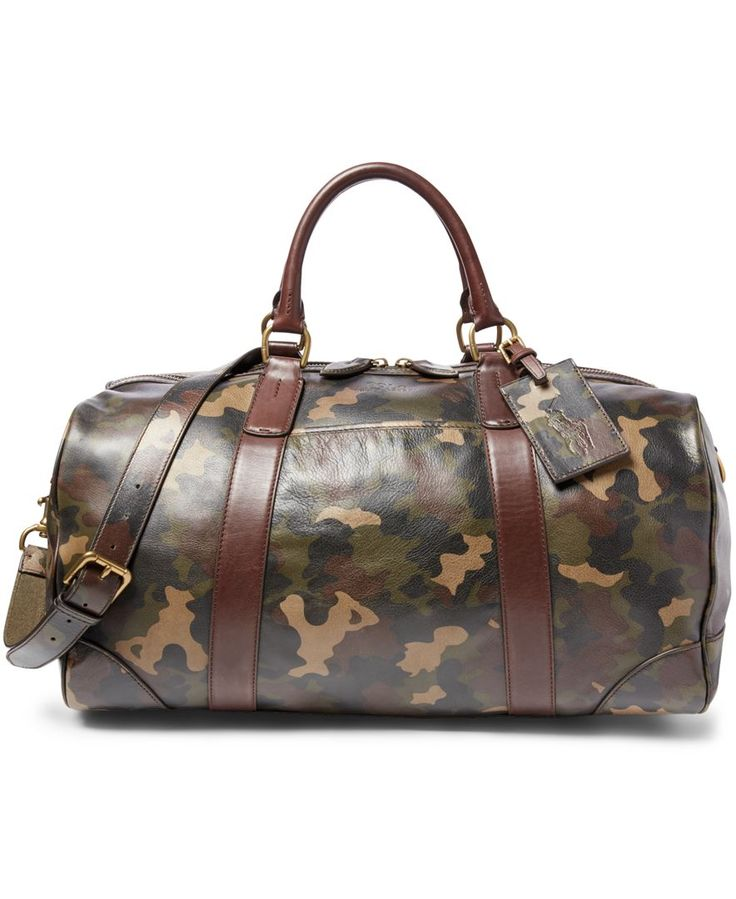 Ideal for work or weekend travel, this spacious duffel bag from Ralph Lauren is crafted from luxurious leather and features a removable shoulder strap. A rugged camo print adds dimensional appeal. | L