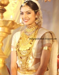 Latest Indian Gold and Diamond Jewellery Designs: South Indian actresses in beautiful wedding jewellery