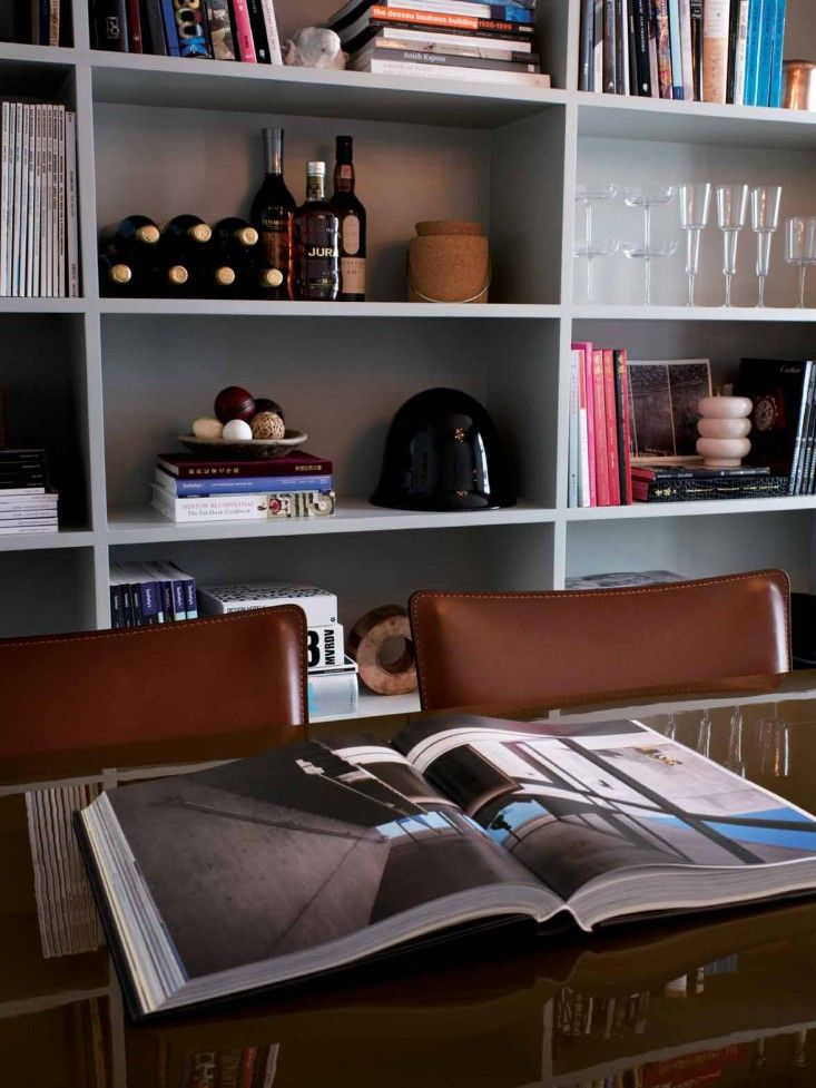 TwoTwoSix Hollywood Road in Hong Kong by Studio Ilse | Remodelista - great styling of books and glassware
