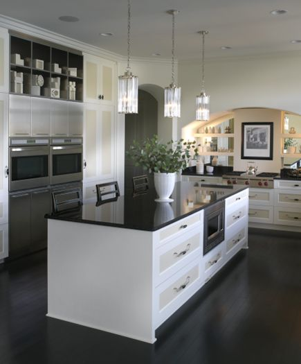 Two Toned Cabinetry And Highly Reflective Surfaces Bring A Whole New Meaning To Kitchen
