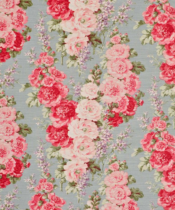 Fabric.  Cabbage roses on a blue/gray background.