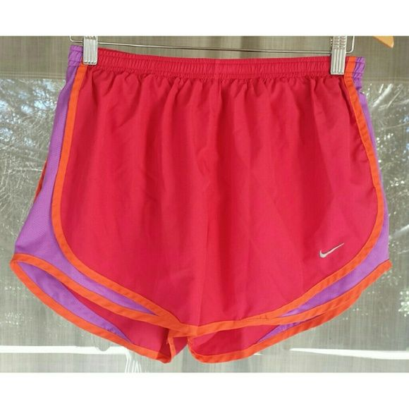 Nike tempo shorts in pink - Norts Nike tempo shorts in pink, with purple insets and orange lining details. Built in bloomers in same pink as shorts. Gently used. Nike Shorts