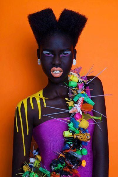 The contrasting bright colors against her beautiful chocolate skin are beautiful. This is an editorial style shoot.
