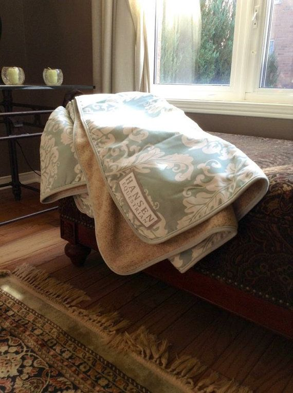 At Hansen Equestrian we like to spoil riders, parents, coaches and judges just as much as the horses we all love so much. Our throw blankets let you take the comfort and quality of the Hansen products all the way home to your couch.  The blankets are 4.5′ x 5′ and are made from the same micro-fibres as our other products and lined with our Berber fleece to keep you nice and warm.  Because of the wash-ability of our fabrics you can take your throw to the horse show to sit on all day, take it…