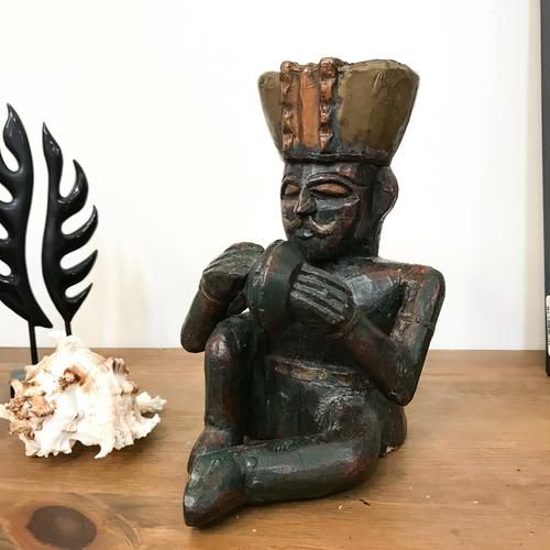 """This quirky African style sitting man statue would look amazing in your """"Man's Den"""" or British Colonial style home.  Made from heavy carved wood and brass and copper top."""