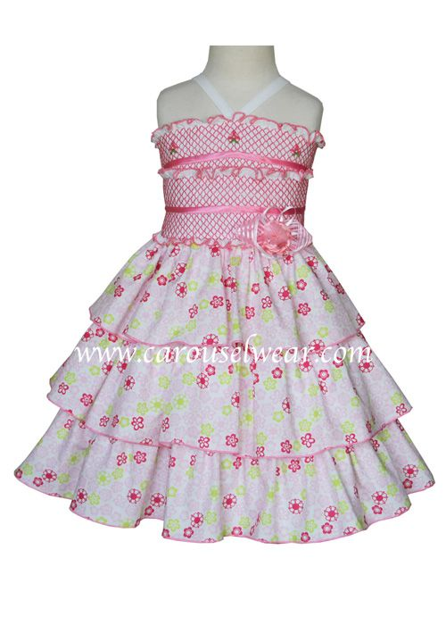 This beautiful pink summer girls dress is absolutely divine, it has three ruffled bands in the skirt, the bodice of the dress is smocked and satin ribbons run across. Just perfect for your little prin