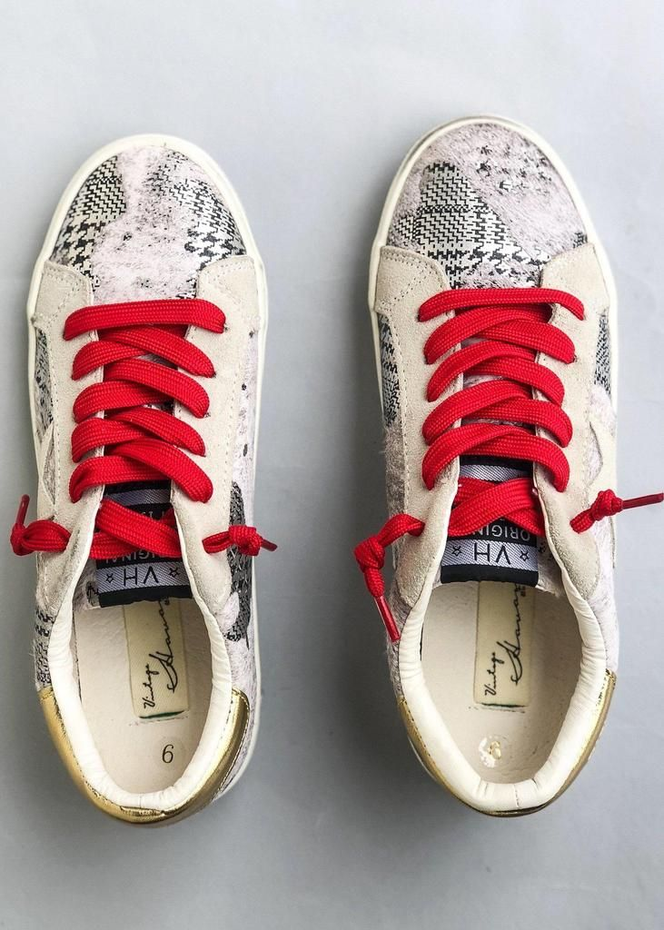 5a5a66bd4d92 The Vintage Havana Passion Houndstooth Sneakers come with both red and  white laces for versatility.