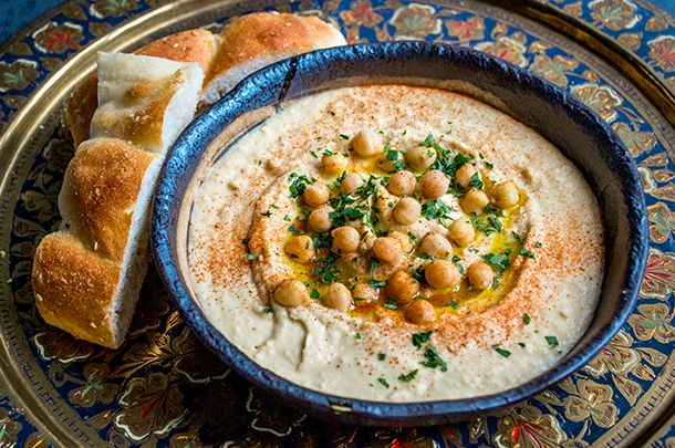 hummus recipe - 2 tins chickpeas, 4 tsp tahina, 2 garlic cloves, 6 tsp good olive oil, 3 1/2 tbsp lemon juice and tsp salt. Drain cans but keep the liquid. Rinse chickpeas and put in processor with other ingredients + 7tbsp of the saved liquid, slowly pour in the oil as it runs to get right consistency. Drizzle oil, add few chickpeas, parsley and paprika to decorate
